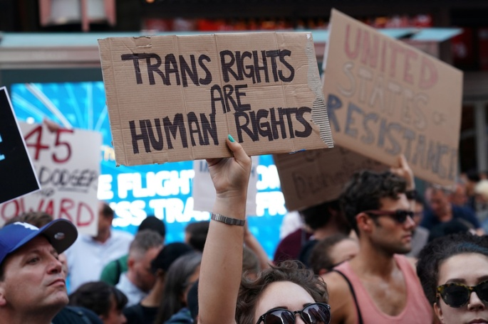 People protest U.S. President Donald Trump's announcement that he plans to reinstate a ban on transgender individuals from serving in any capacity in the U.S. military, in Times Square, in New York City